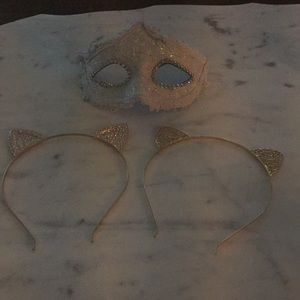 7 hair accessories and mask.  Cat ears